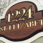 1124 East Elizabeth monument sign close up of gold leaf letters and routed art element Fort Collins CO