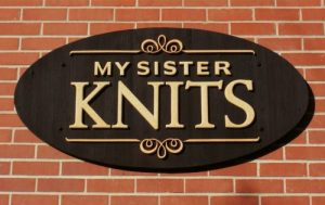 My Sister Knits sandblasted dimensional exterior sign with textured handcrafted letters in Fort Collins CO