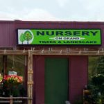 store front sign for nursery on grand