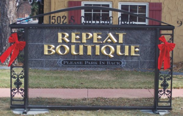 repeat boutique sign