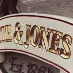 Alias Smith and Jones dimensional sandblasted sign close up of gold leaf letters