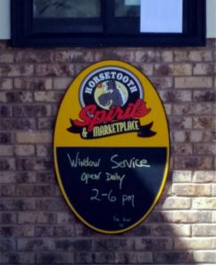 horsetooth spirits and marketplace door sign